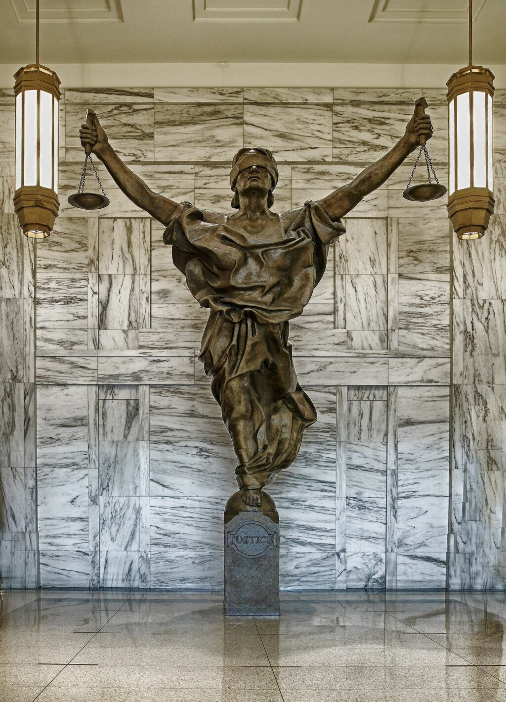 Lady Justice in court depicting punitive damages