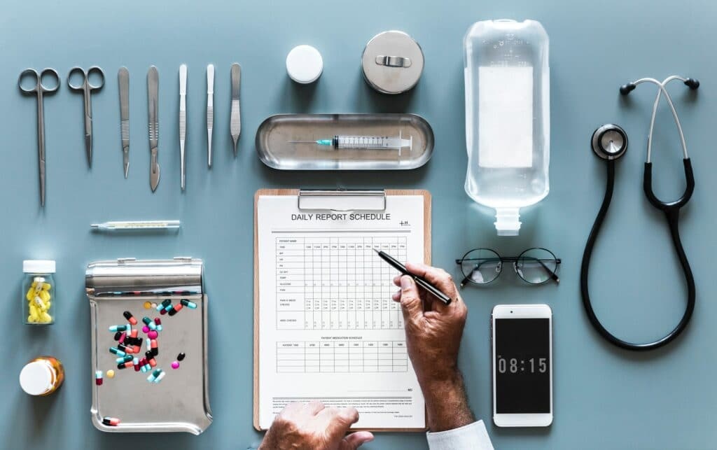 Doctor writing schedule on desk representing hospital charges